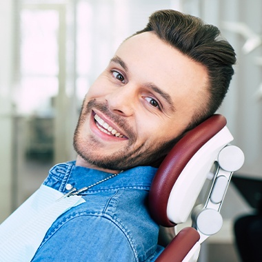 Man in dental chair for root canal therapy
